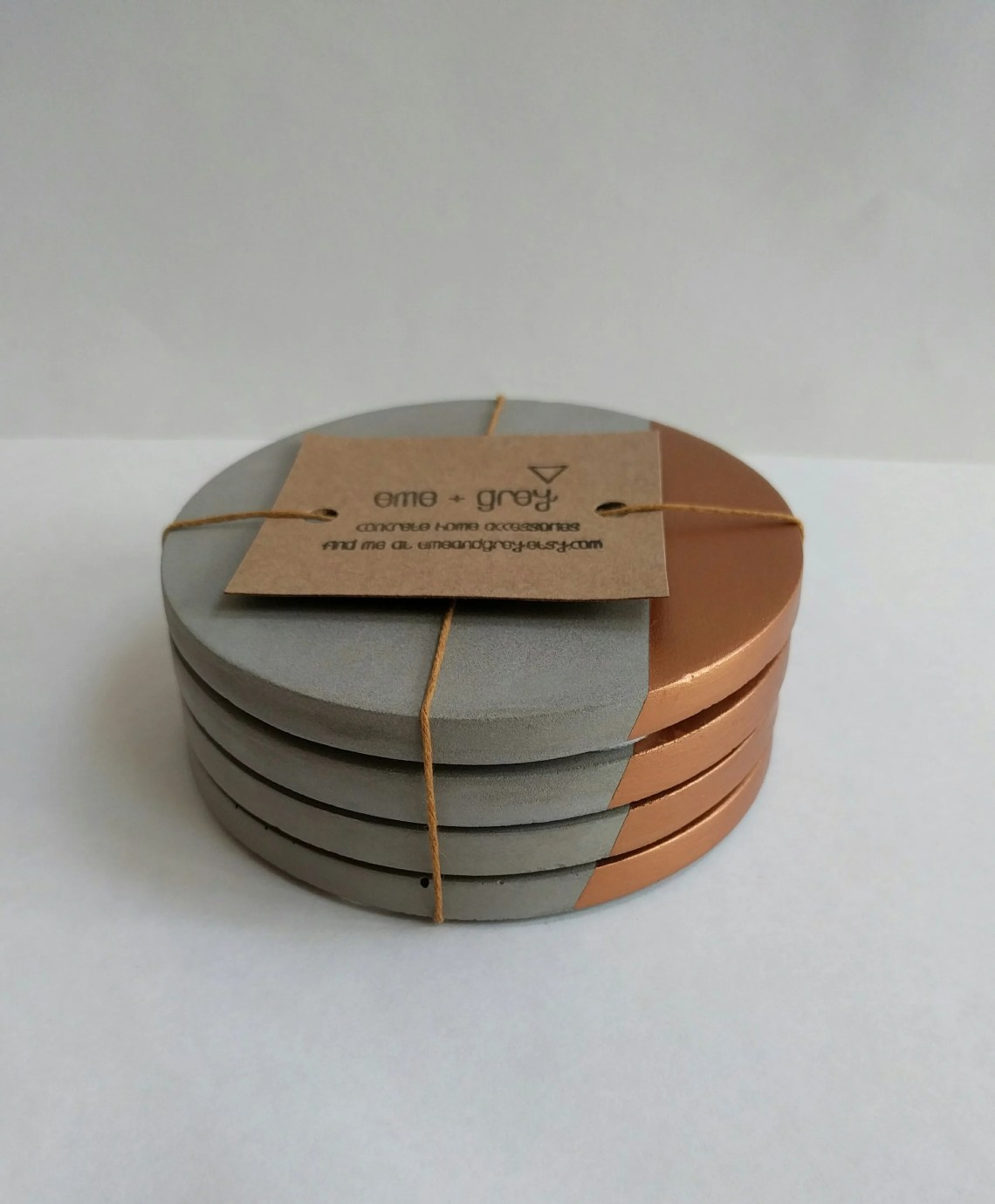 Rose gold and concrete coasters by Eme and Grey