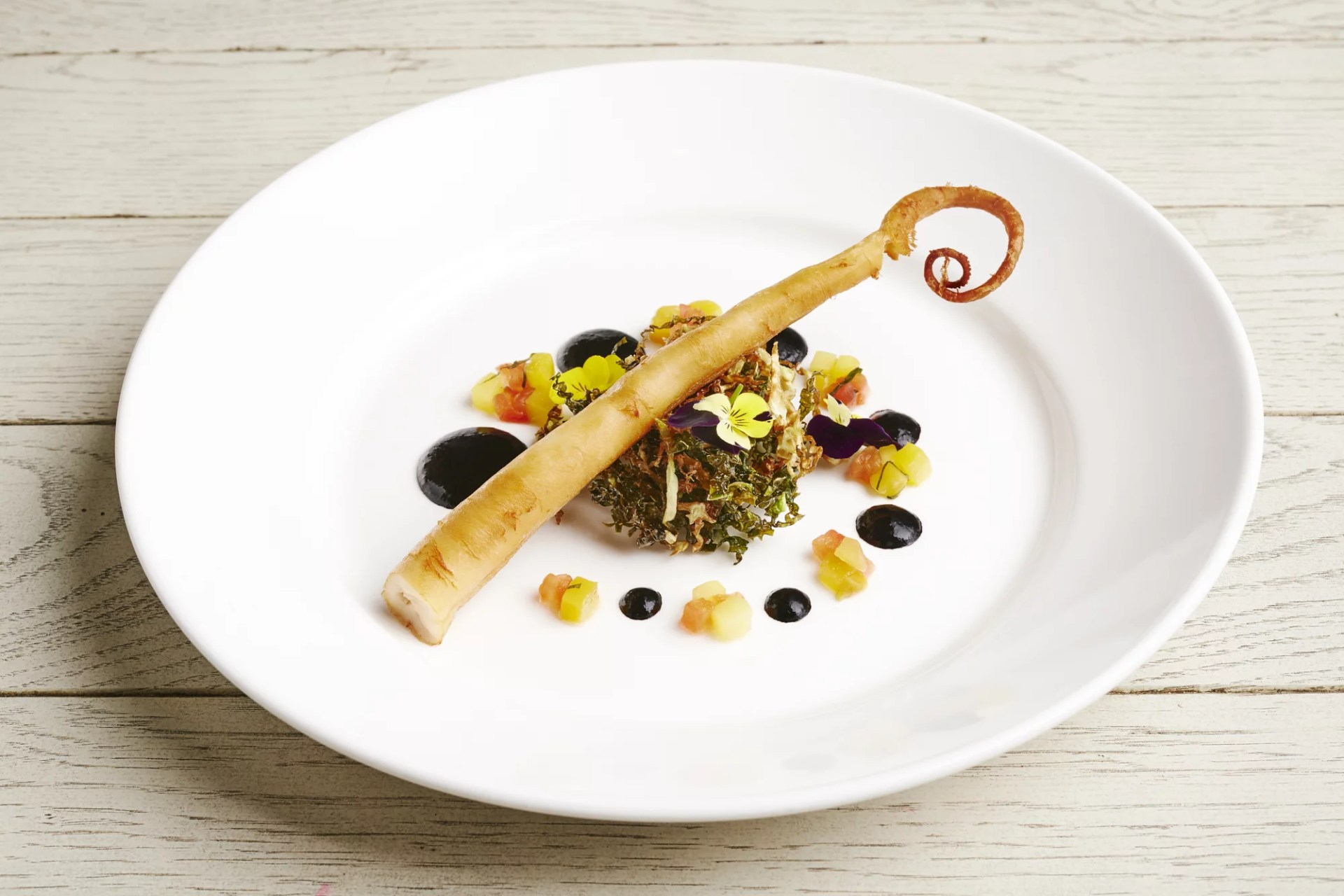 Octopus with squid ink and cherry sauce