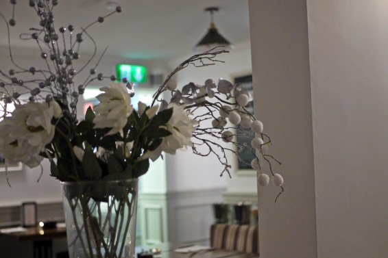 Provenance interior with flowers near table area