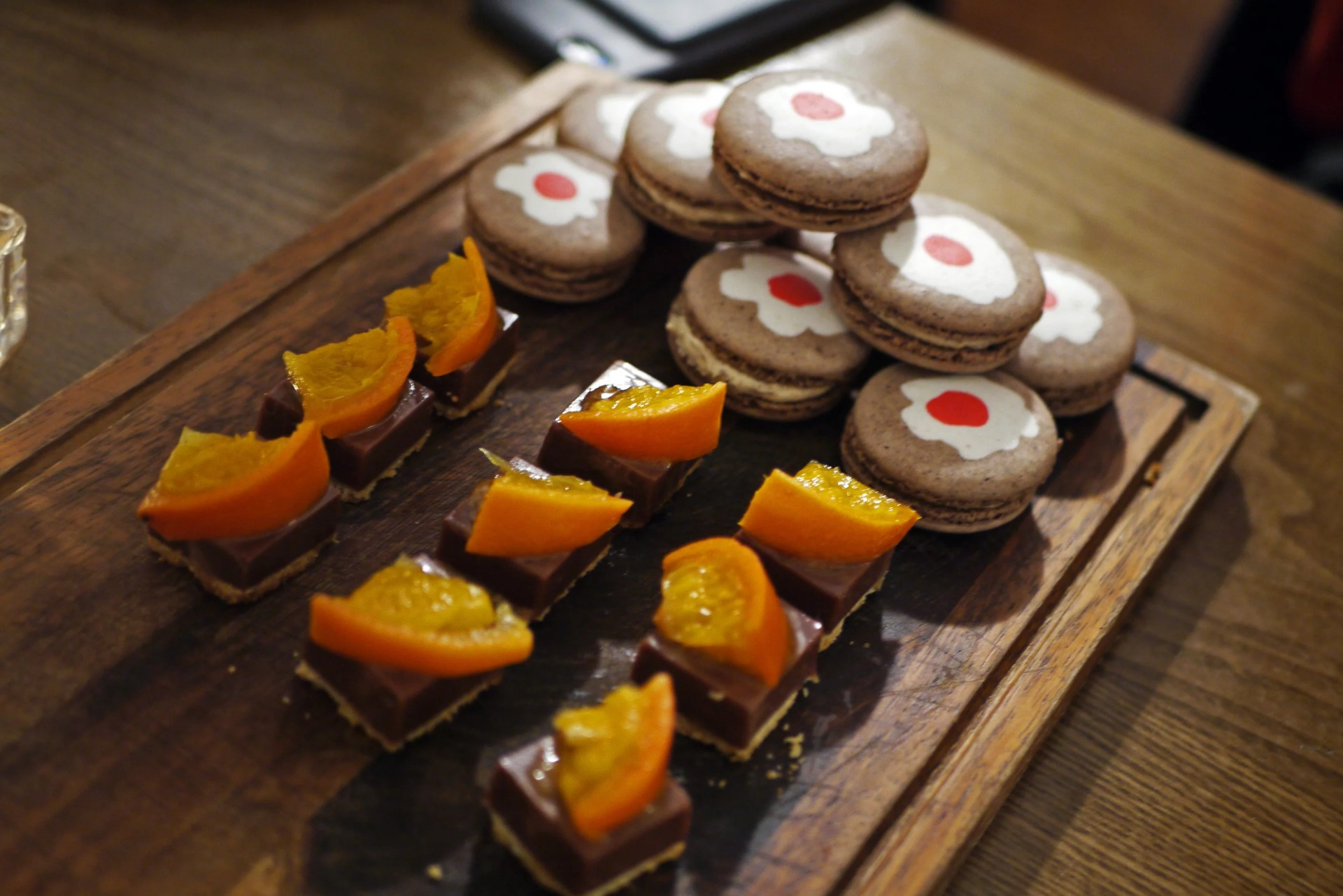 Bite-sized chocolate orange bites and christmas pudding macarons based off the desserts in Provenance's Christmas Fayre menu