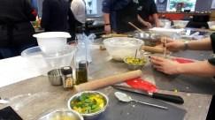 The class underway, kitchen utensils and bowls on a kitchen island