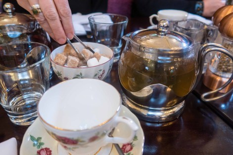 Teapot and teacup with a bowl of sugar