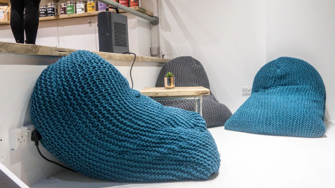 Some comfy bean bags, chairs and stools for sitting on
