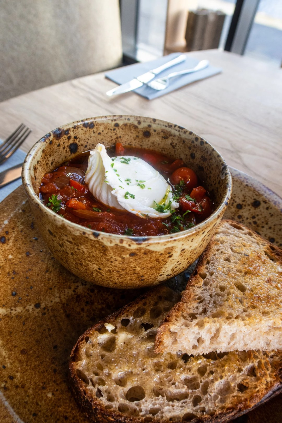 Shaksuka, an Israeli dish with roasted peppers in a rich tomato, cumain and saffron Ragu. Served with sourdough toast and poached egg. £8 (v)