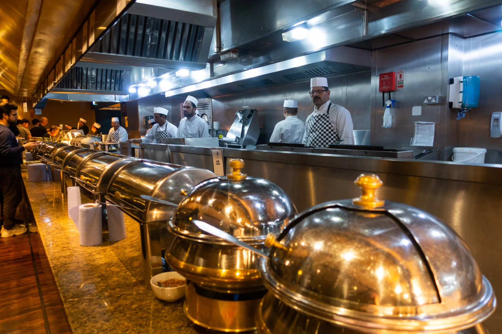 Chefs lined up before the buffet tables