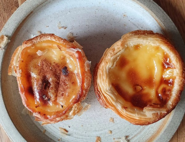 Portuguese tarts on a plate. Just Natas on the left and the Lidl one on the right.