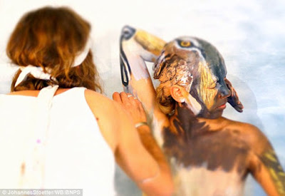 Bodypainter transforms three naked women into a howling Wolf  6