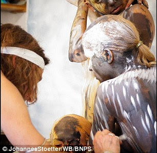Bodypainter transforms three naked women into a howling Wolf  7
