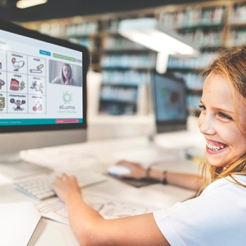 Girl smiling while working at computer
