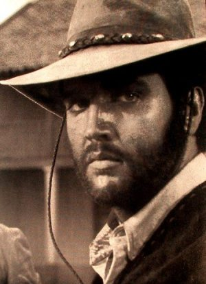 Always Divided: photo of Elvis from the 1968 movie CHARRO.