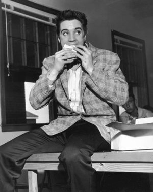 Good Omens: photo of Elvis eating a sandwich in 1957.