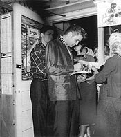 Elvis signs autographs for fans in Dallas, Texas, 1955 - photo from Stanley Oberst's collection
