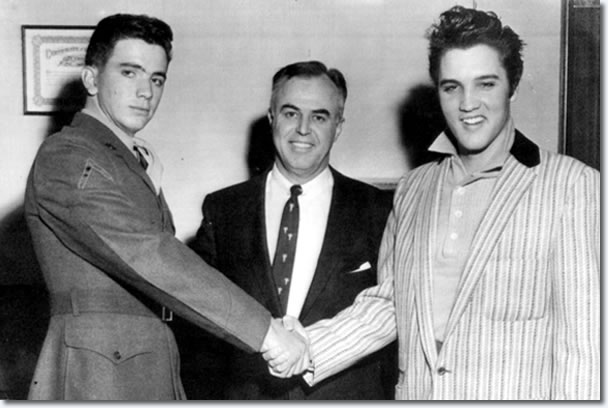 Pfc. Hershel Nixon (left) and Elvis Presley shake hands to show that all is well after the incident.