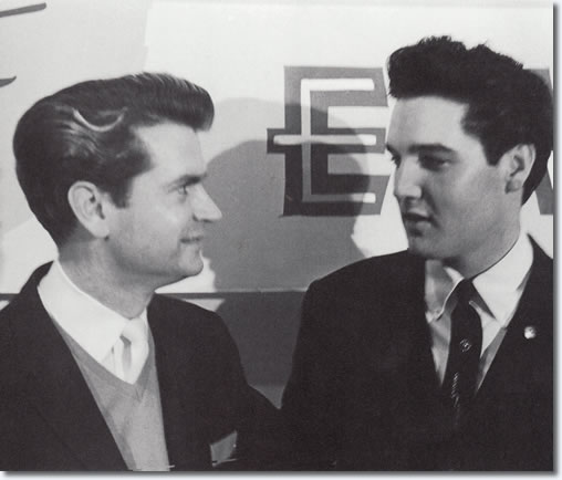 At the 1:45 pm press conference, Sam Phillips asks why Sun Records gets so little recognition for Elvis' success, reminding everyone that 'RCA wouldn't have him if it wasn't for Phillips.