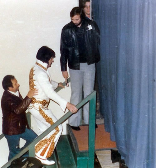 Joe Esposito, Sam Thompson and David Stanley with Elvis as he hits the stage in Charlotte, NC on February 20, 1977.