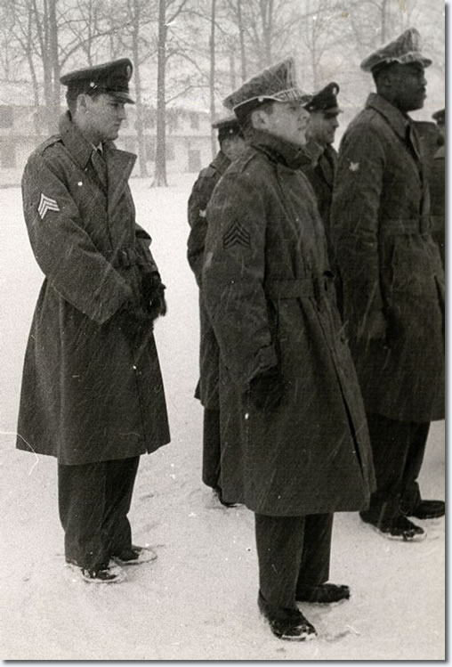 Elvis Presley (left), being discharged from the Army with Rex Mansfield (foreground, right), in 1960.
