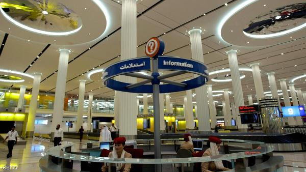 Employees at Dubai International Airport's new Terminal 3 sit behind an information desk at the duty free market on October 9, 2008. The fast growing emirate of Dubai continues to pump cash into developing its airport, with Terminal 3 expected to open by October 14, 2008 aiming to increase the number of passengers to 60 million in 2010. More than 100 airlines now offer flights from Dubai, one of the seven members of the United Arab Emirates, to over 160 destinations around the world. AFP PHOTO/MARWAN NAAMANI (Photo credit should read MARWAN NAAMANI/AFP/Getty Images)