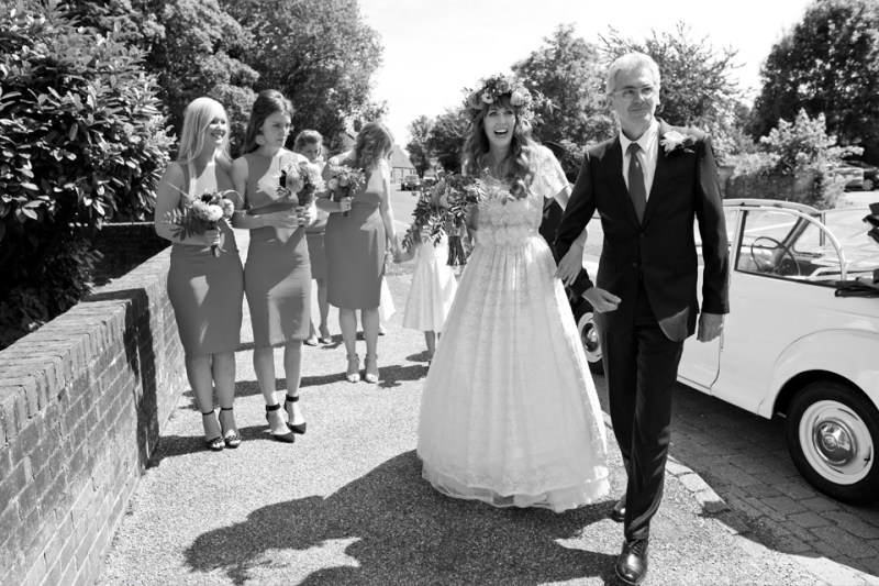 english countryside barn wedding bridal party arrives church