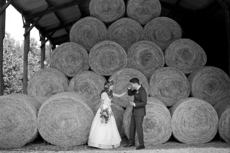 english countryside barn wedding bride groom portraits hay bales farm