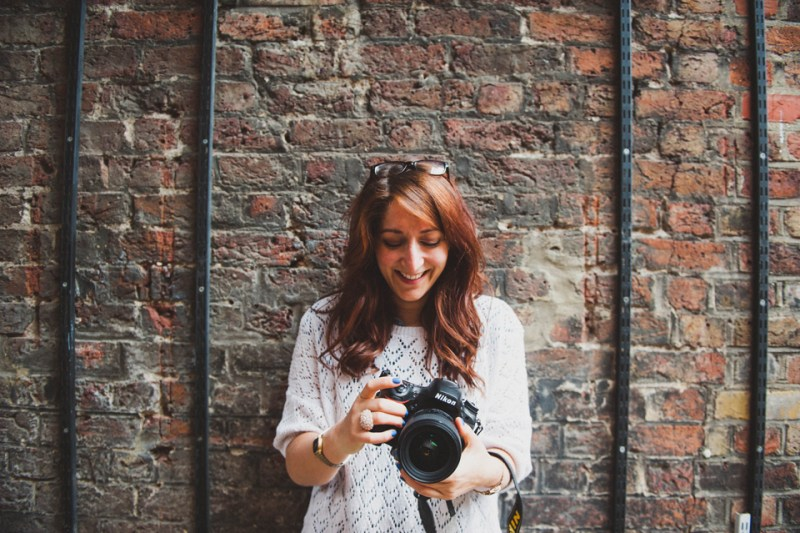 documentary wedding photographer london giggling brick wall