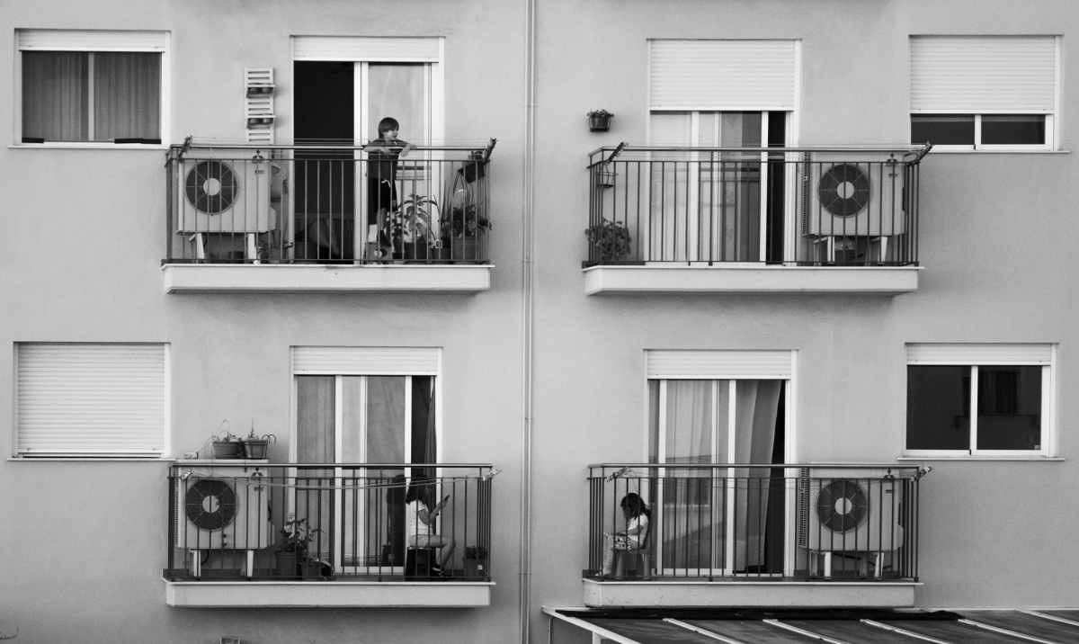 children playing on balconies of modern building