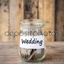 Coins In Glass Money Jar With Wedding Label, Financial Concept