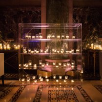 Plexiglass Candle Display At Outdoor Wedding Reception