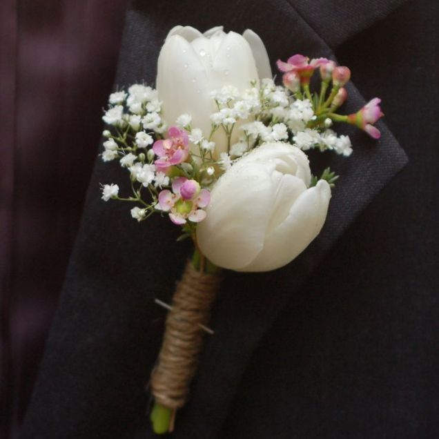 White Tulip, Wax Flower, And Baby's Breath Mother Of The Bride