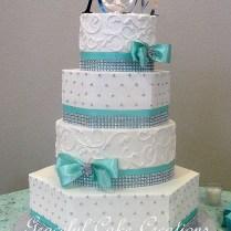 Elegant Mixed Shape White Butter Cream Wedding Cake With T…