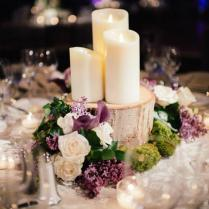 Wood Led Candles And Purple Flowers Winter Wedding Table Decor