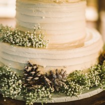 A Delicious Buttercream Wedding Cake Decorated With Babys Breath