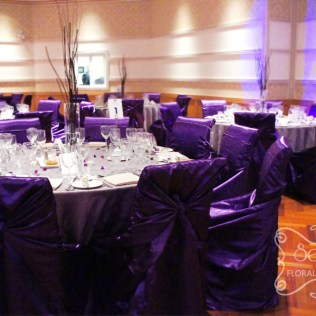 A Purple And Pewter Silver Wedding Reception Decoration