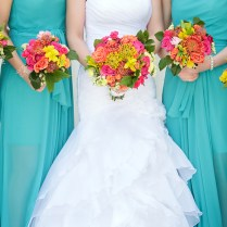 The Bridesmaids Carried Smaller Versions Of The Brides Bouquet