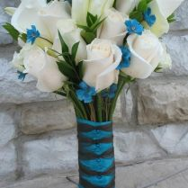 White And Teal Flower Centerpieces