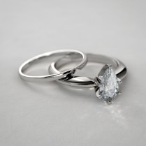 Pear Shaped Diamond And Notched Wedding Band Set In 14k White Gold