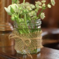 Jam Jars With Flowers And Hessian