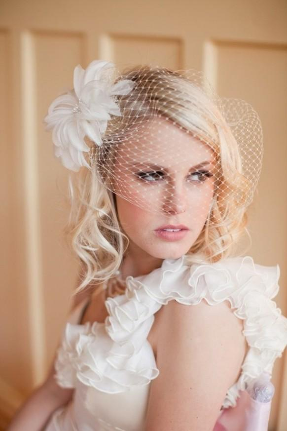 The vintage wedding hairstyles with birdcage veil consider