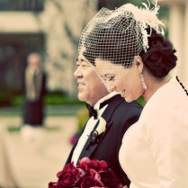 Vintage Glam Bride Wears Birdcage Veil And Dress With Covered Buttons