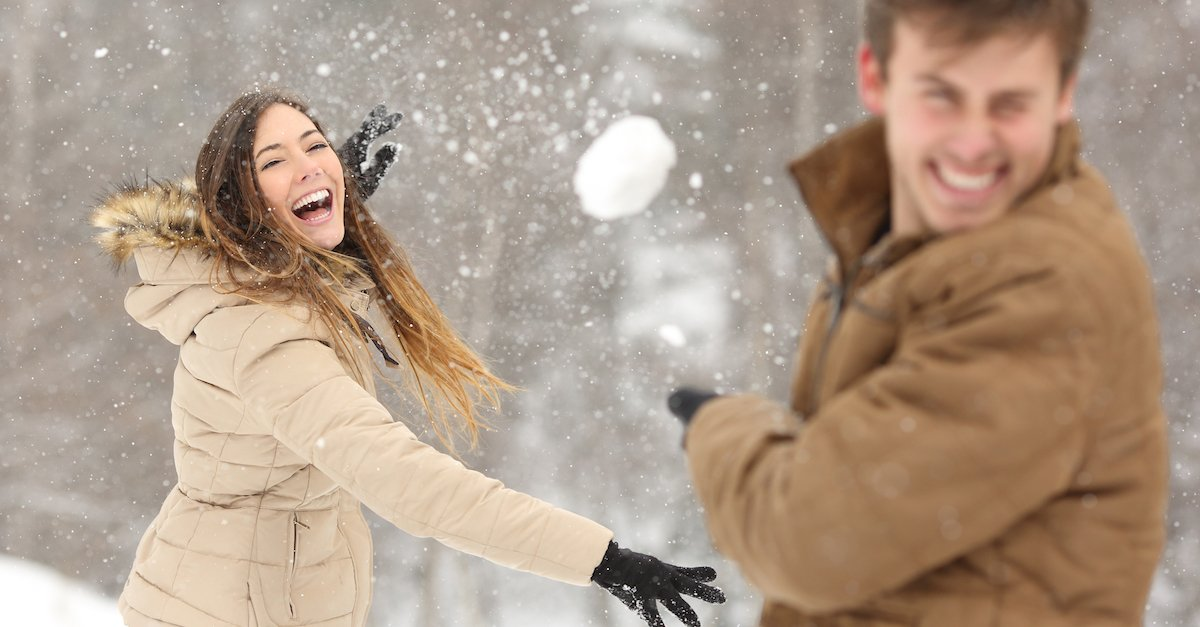Couple playing with snow