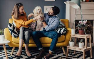 Couple with dog on couch