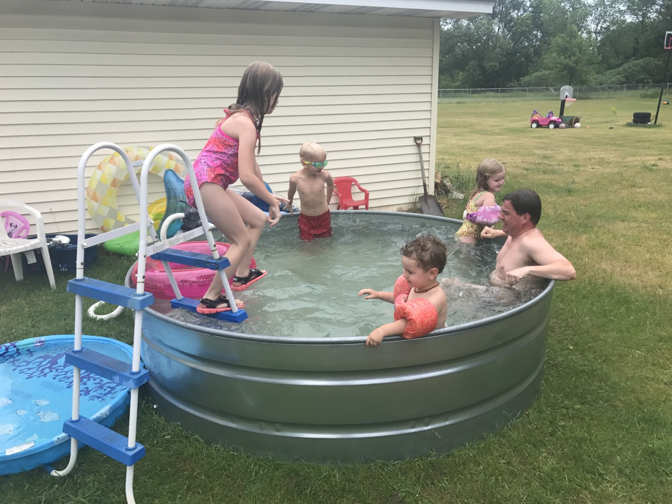 How to Make a Stock Tank Pool   Embracing Motherhood