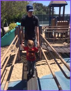 Dad helping kid cross bridge