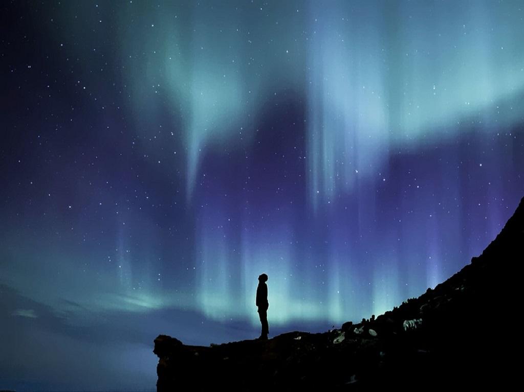Standing on a mountain tip having spiritual awakening