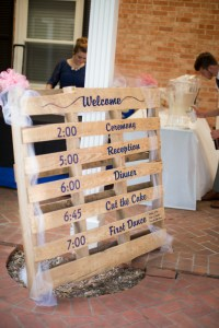 Vinyl Signs and Vinyl Lettering on a Palette showing Store Hours by Embroider It in Columbia MO
