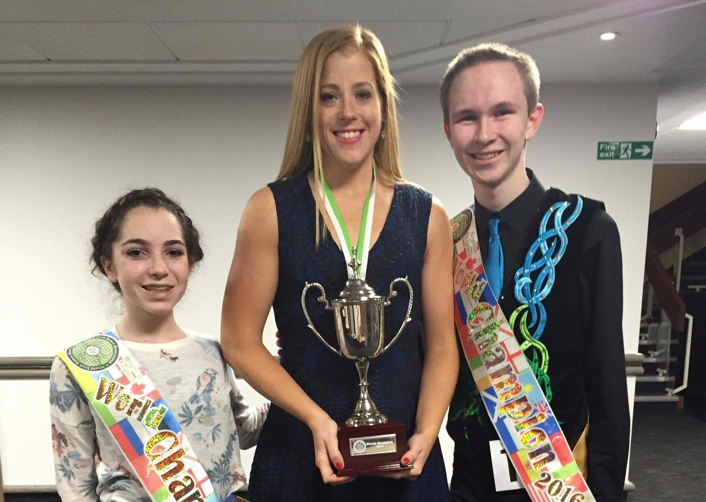 Emerald Isle Academy's two world champions with their instructor, Kate O'Brien.