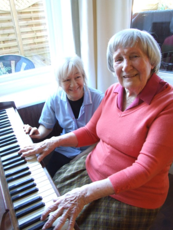 Female Client Playing Piano
