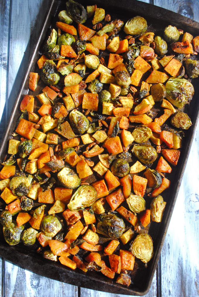 Slightly sweet with a little spice, these Maple Curry Roasted Brussels Sprouts, Butternut Squash and Apples make a delicious side dish for Thanksgiving!