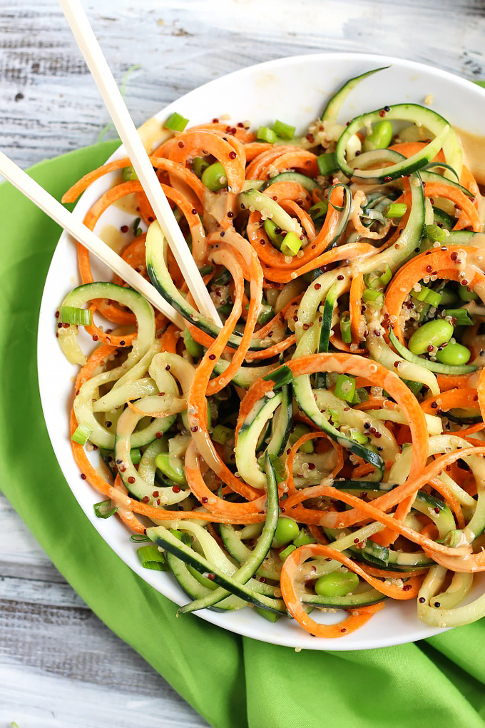 Step up your salad game with this healthy Asian Quinoa Salad featuring cucumber and carrot noodles! The creamy peanut dressing is the perfect complement.