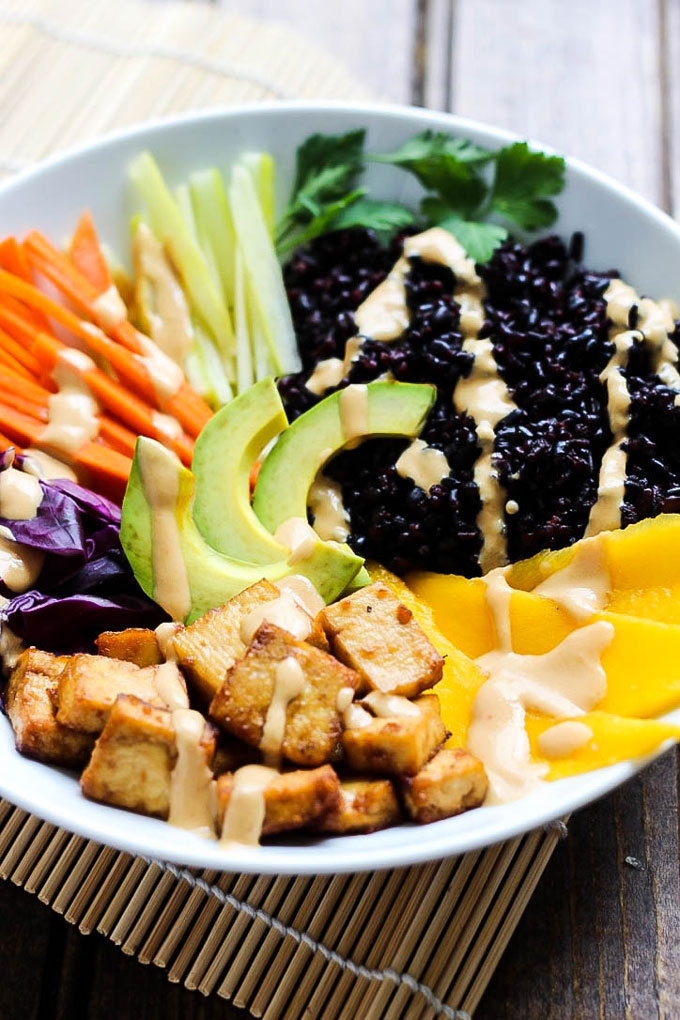 Full of wholesome ingredients, these Tofu & Mango Forbidden Rice Bowls are a colorful dinner that makes great leftovers for lunch. Vegan & gluten-free!