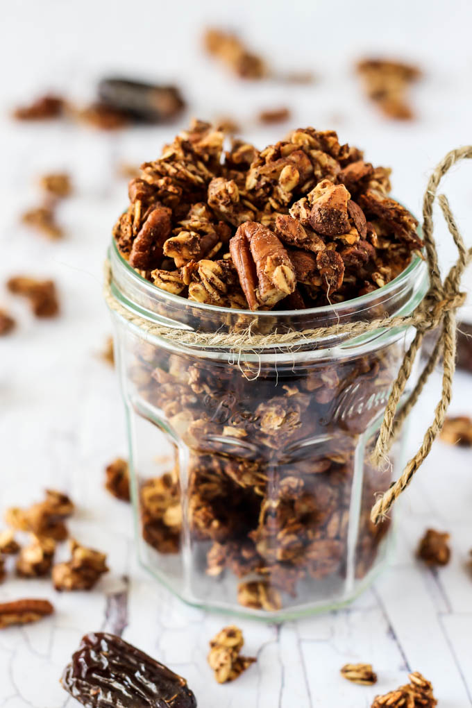 Enjoy the warming flavors in this chunky Chai Spice Granola! It's full of oats & nuts without oil, plus it's completely date-sweetened. Vegan & gluten-free!